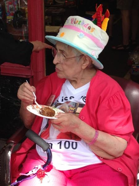 """Ethel's t-shirt says """"Kiss Me, I'm 100""""."""