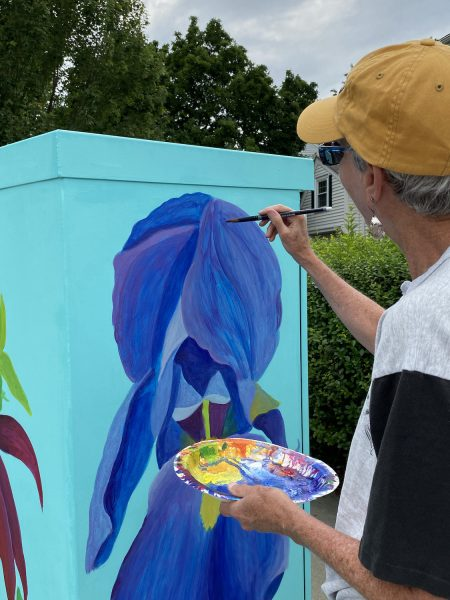 Anne painting layer 1 of the Iris panel on the transformer box